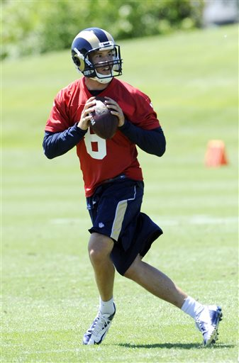 St Louis Rams quarterback Sam Bradford drops back to pass during NFL football practice, Friday, May, 24, 2013, at the team's training facility in St. Louis
