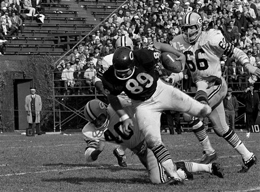 In this Oct. 16, 1966, file photo, Chicago Bears tight end Mike Ditka (89) is tackled after a pass reception against the Green Bay Packers during an NFL football game at Wrigley Field in Chicago. The Bears announced Friday, May 24, 2013, that they will retire Ditka's No. 89  during halftime of the Dec. 9, 2013, Monday Night Football game against the Dallas Cowboys at Soldier Field in Chicago
