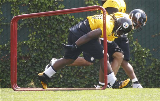 Pittsburgh Steelers defensive tackle Steve McLendon (90), left and defensive end Cameron Heyward (97) participate in drills during NFL football practice on Thursday, May 30, 2013 in Pittsburgh