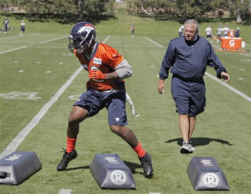 Denver Broncos linebacker Von Miller works out as linebacker coach Richard Smith, right, watches during off season training camp at the NFL football team's training facility in Englewood, Colo., on Monday, June 3, 2013