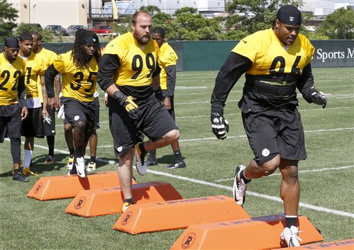 Pittsburgh Steelers defensive linemen Ziggy Hood (96) and Brett Kiesel (99) perform agility drills during the NFL football practice on Wednesday, June 5, 2013 in Pittsburgh