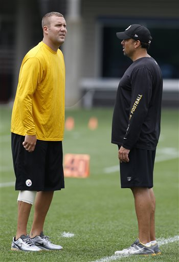 Pittsburgh Steelers quarterback Ben Roethlisberger, left, stands on the field during the first day of their NFL football minicamp on Tuesday, June 11, 2013 in Pittsburgh