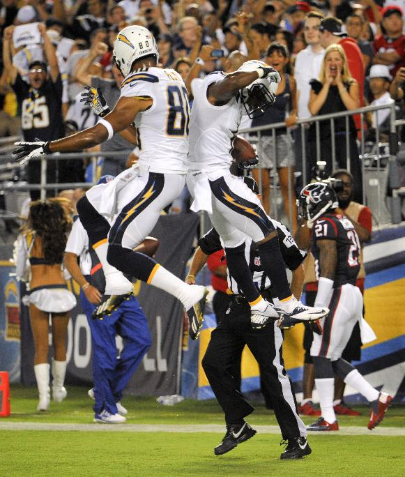 San Diego Chargers wide receiver Eddie Royal, right, celebrates his touchdown with Malcom Floyd against the Houston Texans during the first half of an NFL football game, Monday, Sept. 9, 2013, in San Diego