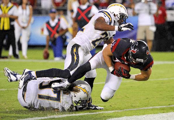 Houston Texans tight end Garrett Graham, right, scores between San Diego Chargers linebacker Bront Bird, left, and running back Ronnie Brown during the second half of an NFL football game Monday, Sept. 9, 2013, in San Diego