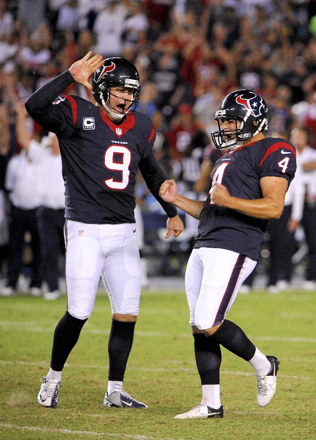 Houston Texans kicker Randy Bullock, celebrates with Shane Lechler after kicking the game winning field goal against the San Diego Chargers during the second half of an NFL football game Monday, Sept. 9, 2013, in San Diego