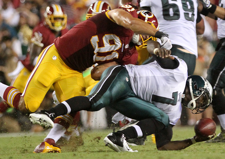 Washington Redskins linebacker Ryan Kerrigan (91) sacks Philadelphia Eagles quarterback Michael Vick during their NFL football game at FedEx Field on Sept. 9, 2013. Monday, Sept. 9, 2013, in Landover, Md