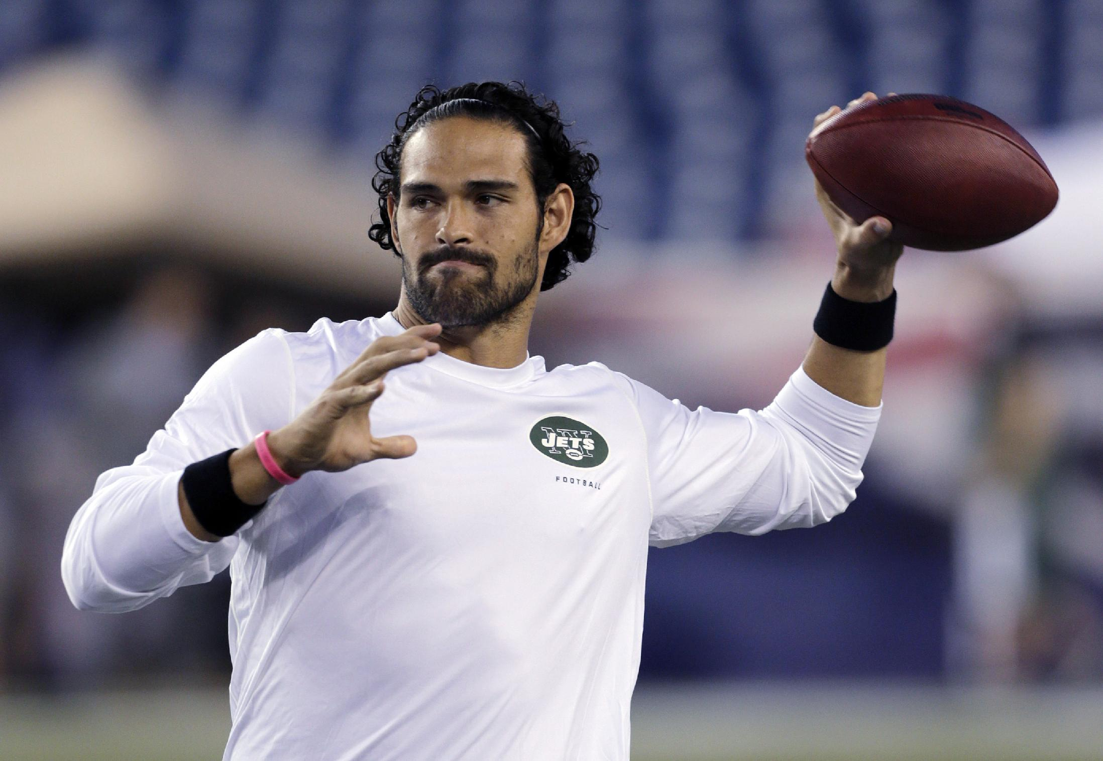 New York Jets quarterback Mark Sanchez, who normally throws right-handed, throws a pass with his left hand before an NFL football game between the New England Patriots and the Jets on Thursday, Sept. 12, 2013, in Foxborough