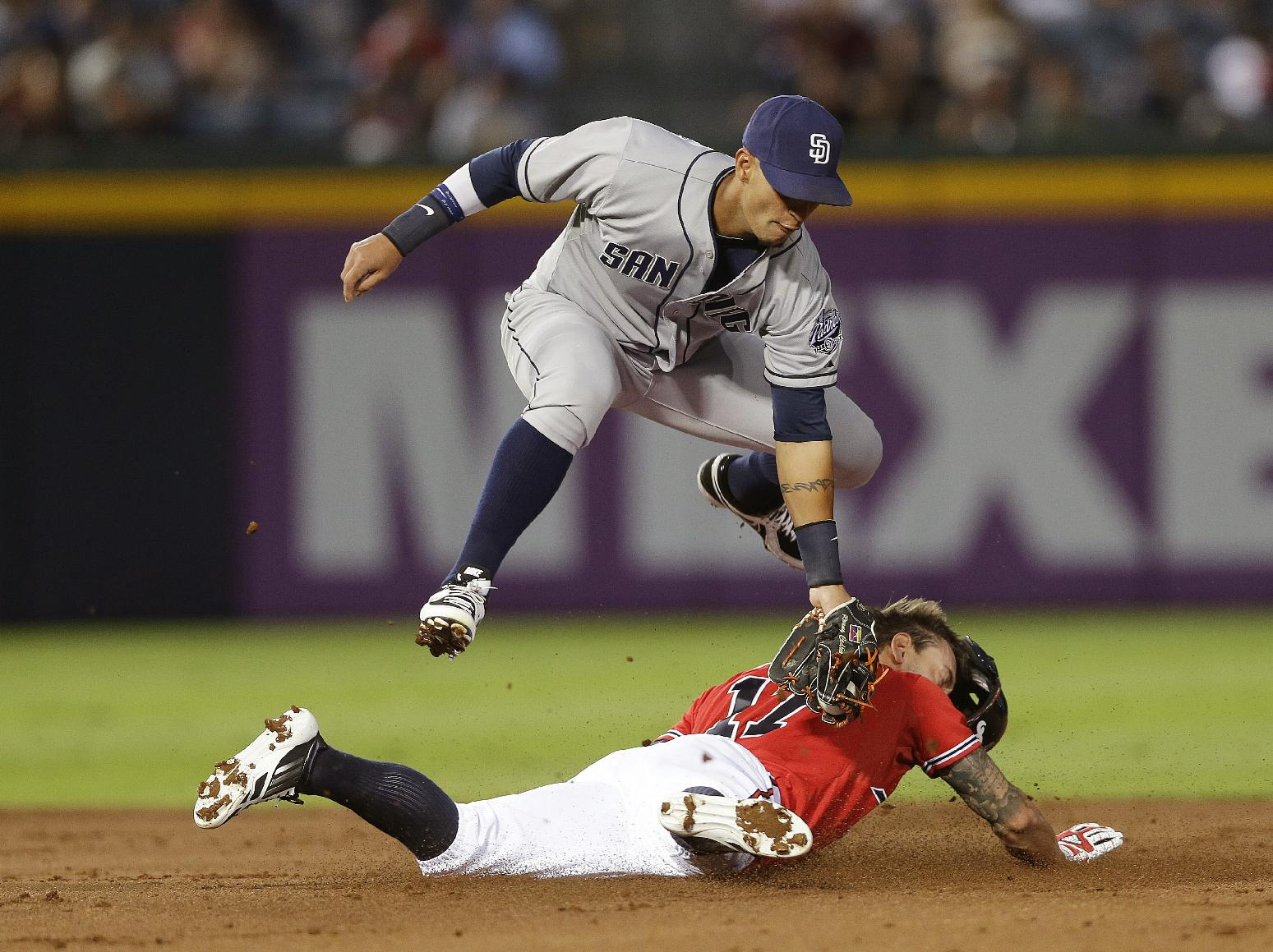 Atlanta Braves Jordan Schafer steals second base as San Diego Padres shortstop Ronny Cedeno handles the late throw in the first inning of a baseball game Friday, Sept. 13, 2013, in Atlanta
