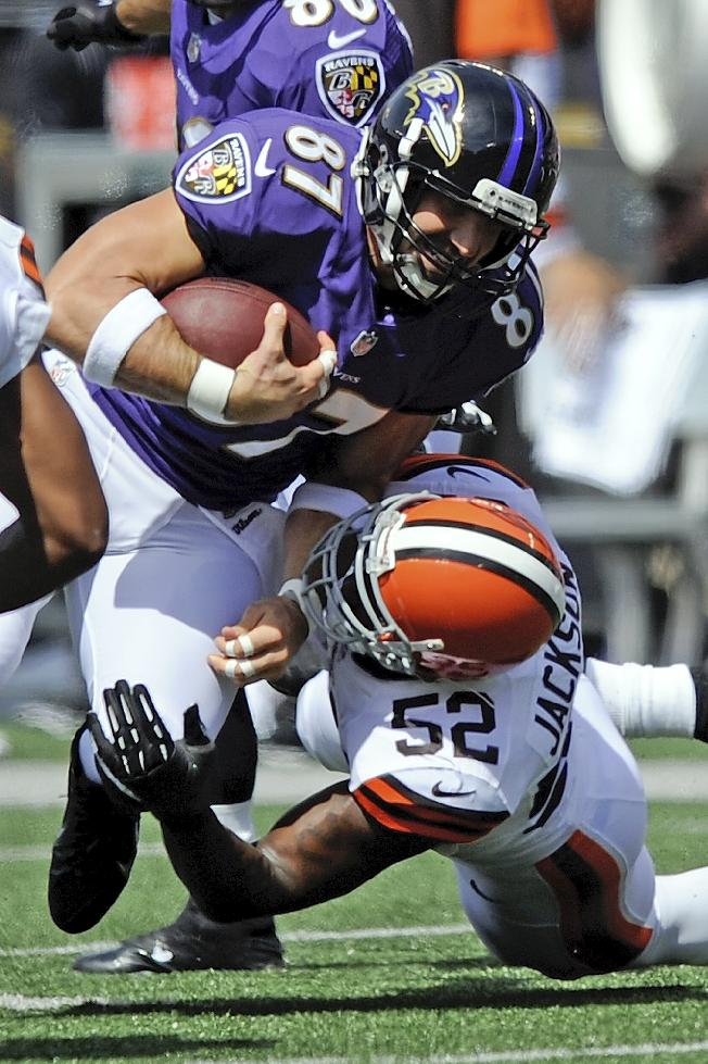 Baltimore Ravens tight end Dallas Clark (87) is tackled by Cleveland Browns inside linebacker D'Qwell Jackson (52) during the first half of a NFL football game in Baltimore, Md., Sunday, Sept. 15, 2013