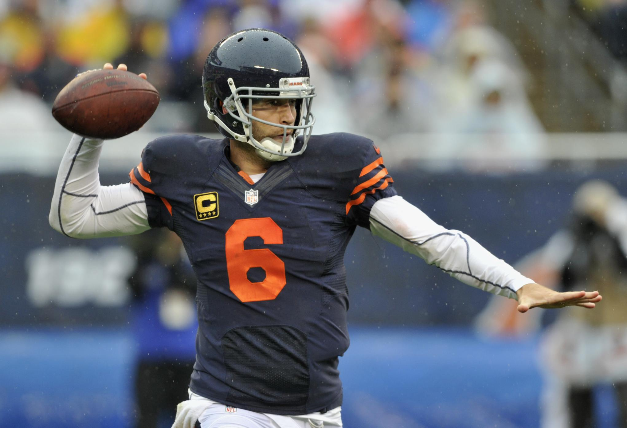 Chicago Bears quarterback Jay Cutler (6) fires a pass against the Minnesota Vikings during the first half of an NFL football game on Sunday, Sept. 15, 2013, in Chicago