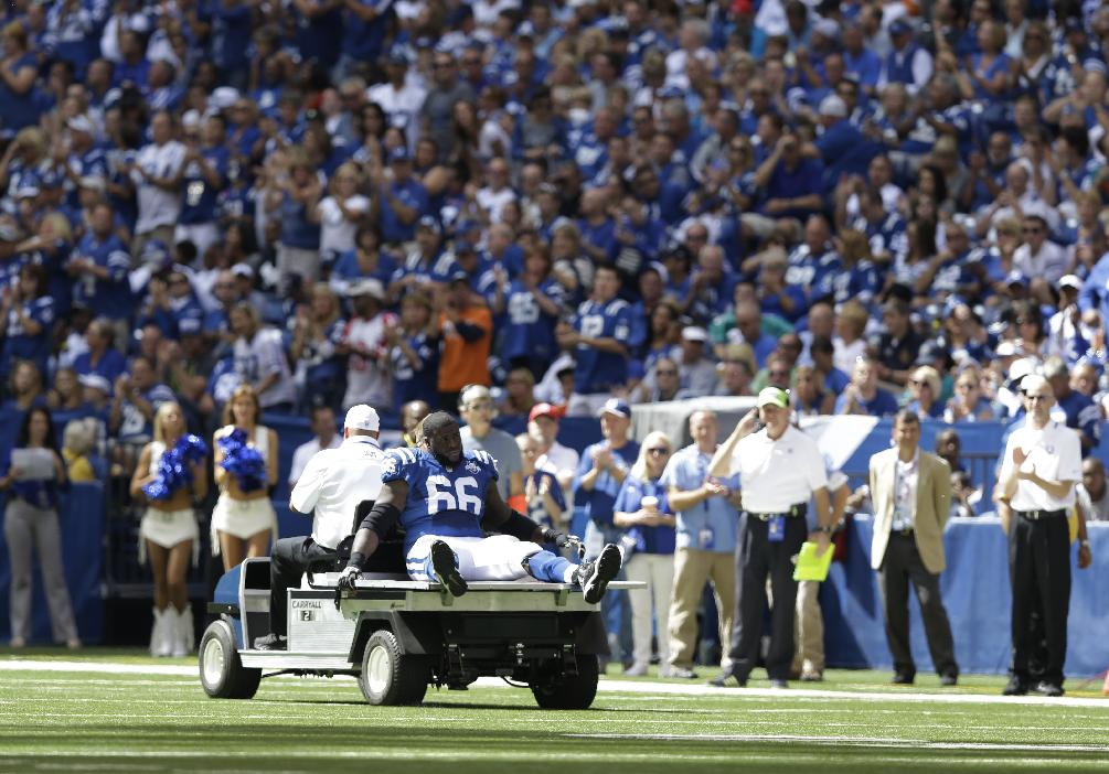 Indianapolis Colts' Donald Thomas (66) is carted off the field after getting injured during the first half an NFL football game against the Miami Dolphins Sunday, Sept. 15, 2013, in Indianapolis