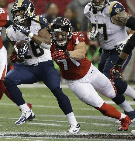 St. Louis Rams running back Daryl Richardson (26) runs past Atlanta Falcons defensive end Kroy Biermann (71) during the first half of an NFL football game, Sunday, Sept. 15, 2013, in Atlanta