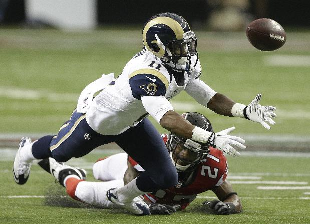 St. Louis Rams wide receiver Tavon Austin (11) vies for a thrown ball against Atlanta Falcons cornerback Robert McClain (27) during the first half of an NFL football game, Sunday, Sept. 15, 2013, in Atlanta