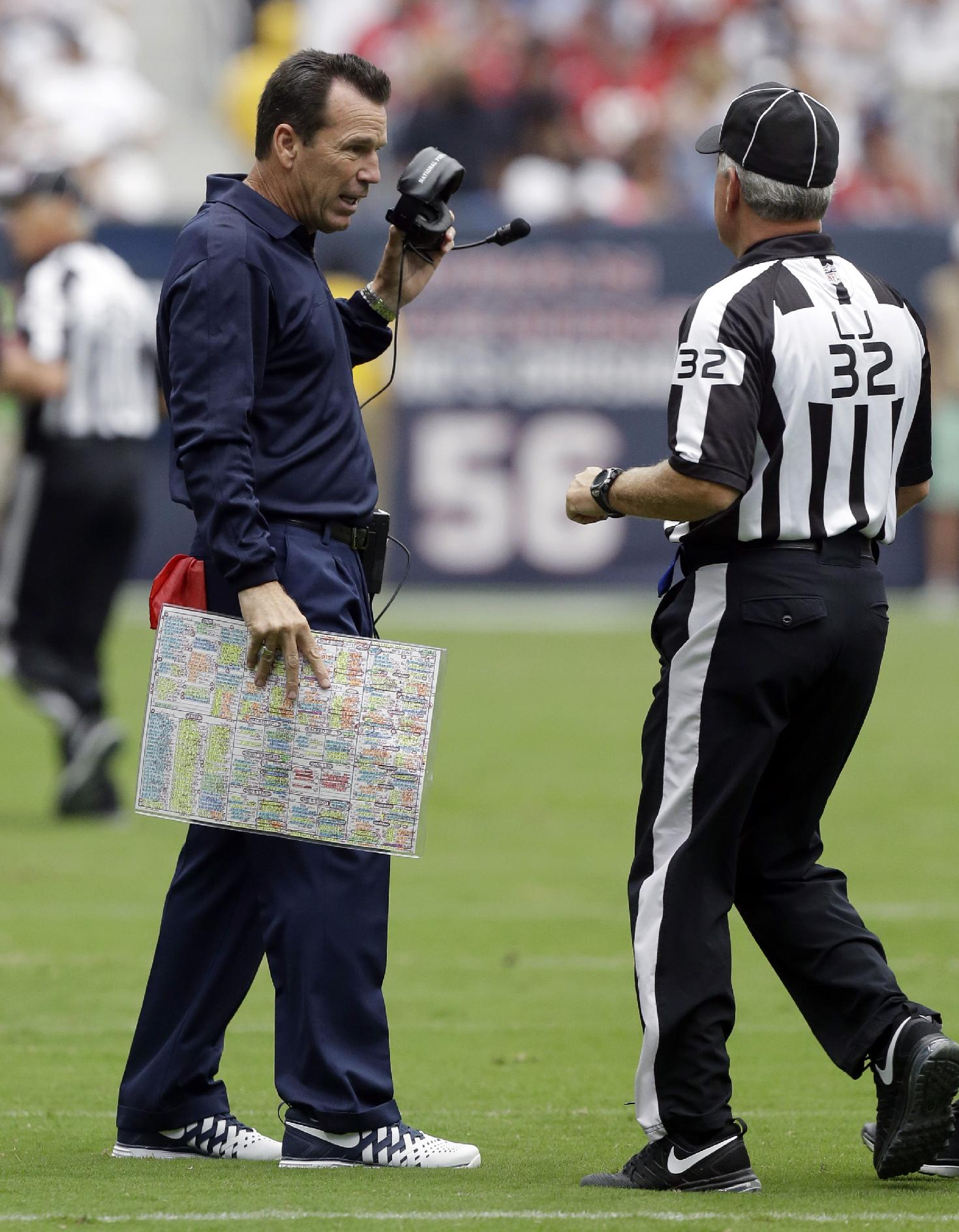 Houston Texans head coach Gary Kubiak, left, talks with and official during the first quarter of an NFL football game against the Tennessee Titans, Sunday, Sept. 15, 2013, in Houston