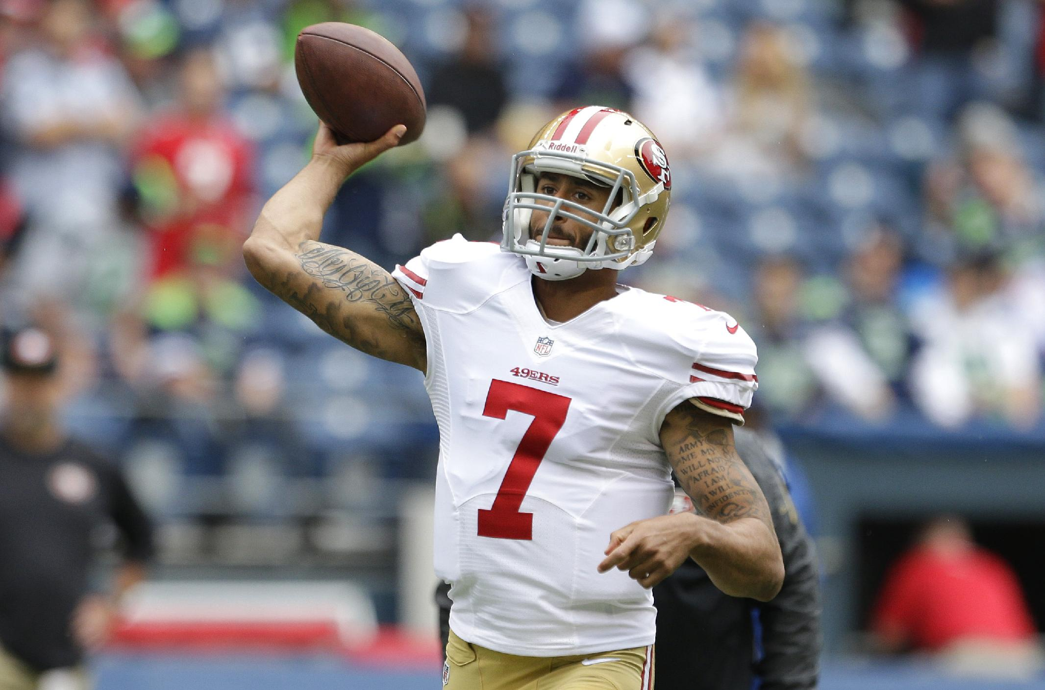 San Francisco 49ers quarterback Colin Kaepernick passes during warm ups before a NFL football game against the Seattle Seahawks, Sunday, Sept. 15, 2013, in Seattle