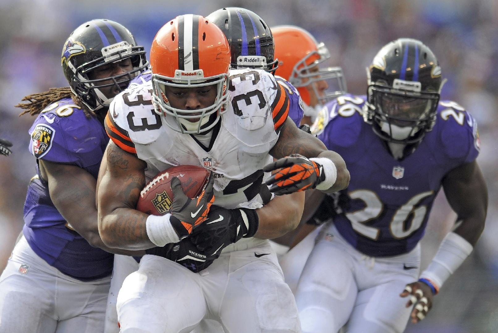 In this Sunday, Sept. 15, 2013, photo, Cleveland Browns running back Trent Richardson carries the ball during an NFL football game against the Baltimore Ravens in Baltimore. The Browns have traded Richardson to the Indianapolis Colts in a surprise move less than two years after drafting him in the first round. The Browns (0-2), struggling on offense under new coach Rob Chudzinski, announced the move Wednesday afternoon, Sept. 18. They will also bring in veteran running back Willis McGahee for a physical