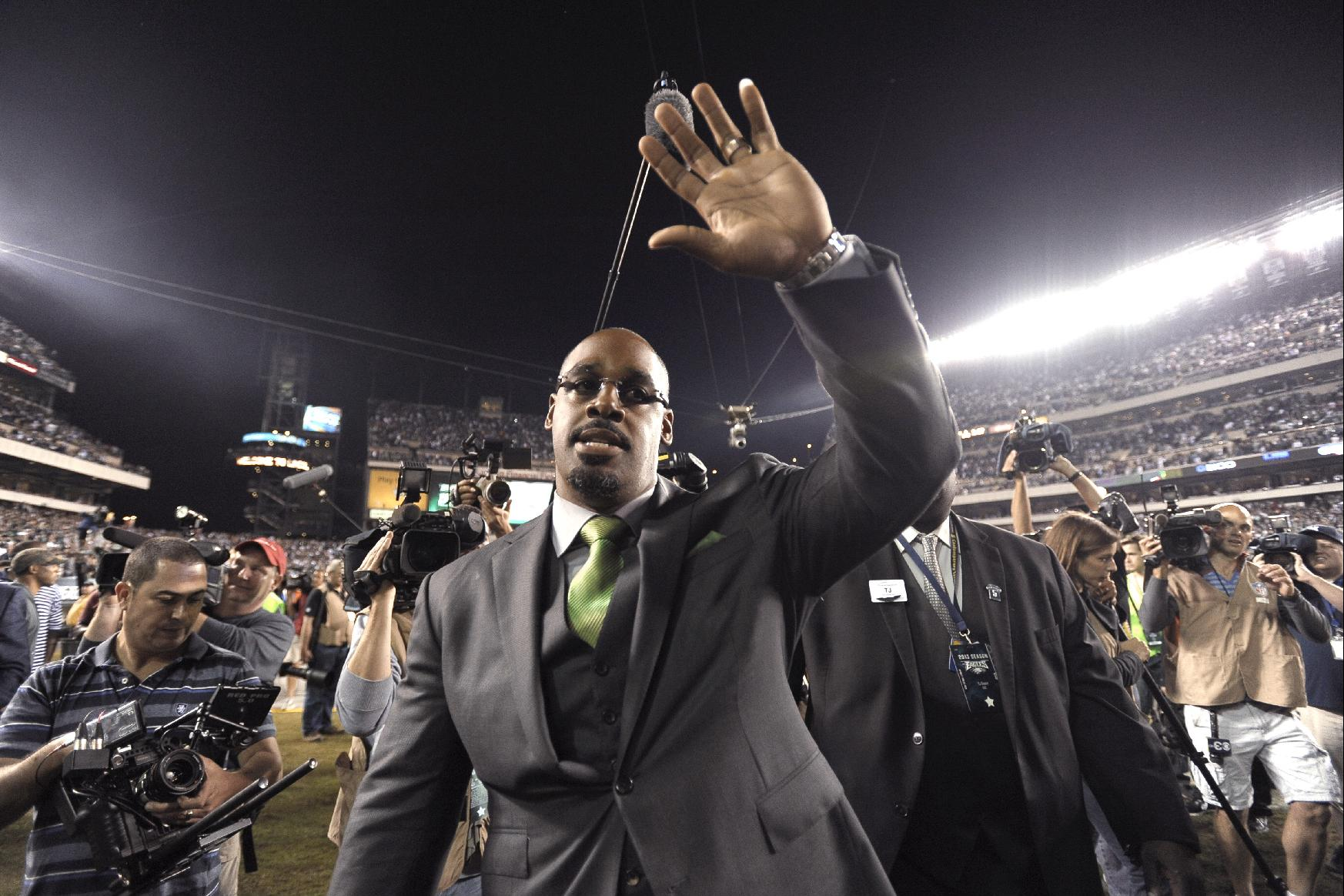 Former Philadelphia Eagles quarterback Donovan McNabb waves to the crowd during halftime of an NFL football game between the Eagles and the Kansas City Chiefs, Thursday, Sept. 19, 2013, in Philadelphia. The Eagles retired McNabb's jersey number at halftime