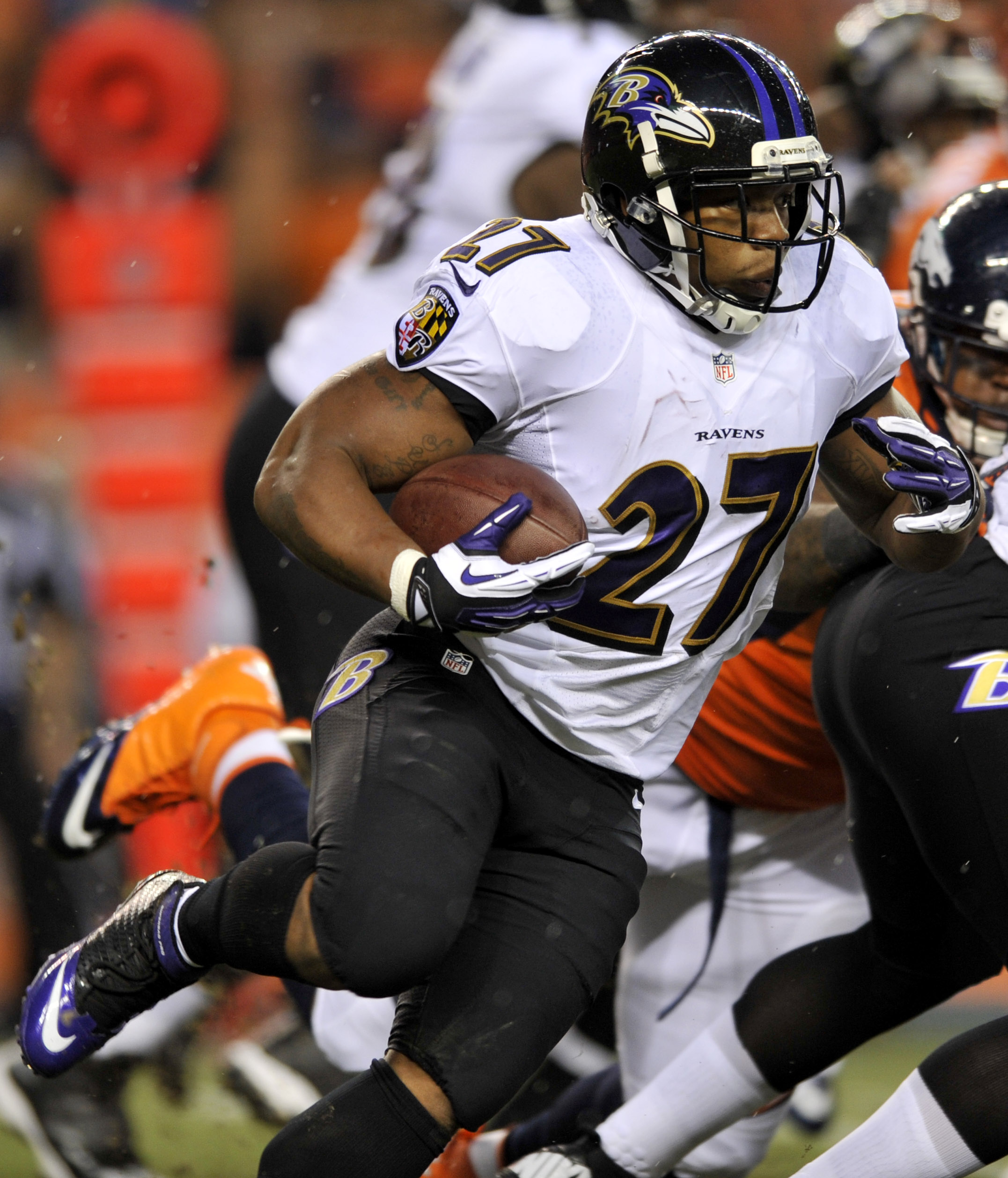 Baltimore Ravens running back Ray Rice (27) runs the ball against the Denver Broncos during the first half of an NFL football game, Thursday, Sept. 5, 2013, in Denver