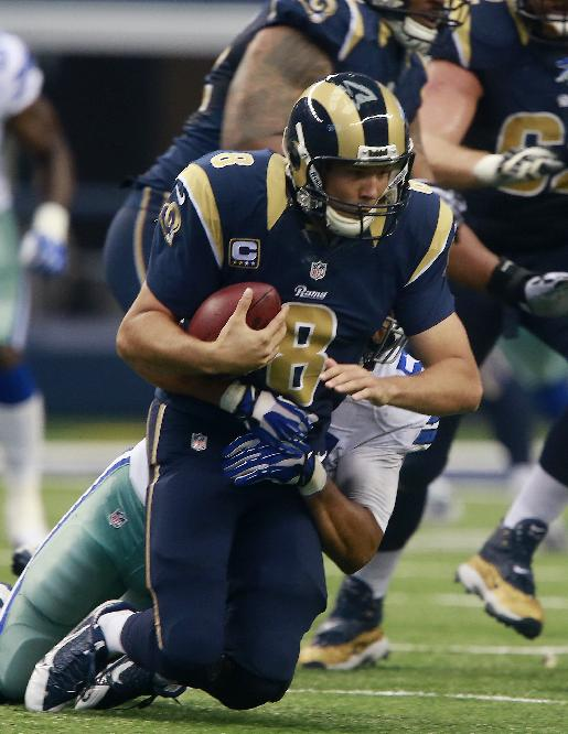 St. Louis Rams quarterback Sam Bradford (8) is sacked by Dallas Cowboys defensive end Kyle Wilber (51) during the second half of an NFL football game Sunday, Sept. 22, 2013, in Arlington, Texas