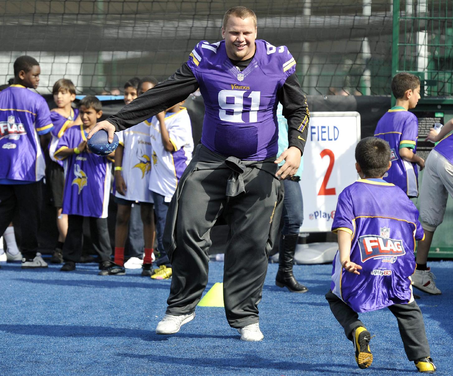 Chase Baker of the Vikings NFL team takes part in a coaching clinic for London children near Wembley Stadium, London, Tuesday Sept. 24, 2013. The Pittsburgh Steelers are to play the Minnesota Vikings in the NFL International Series at Wembley Stadium in London on Sunday, Sept 29