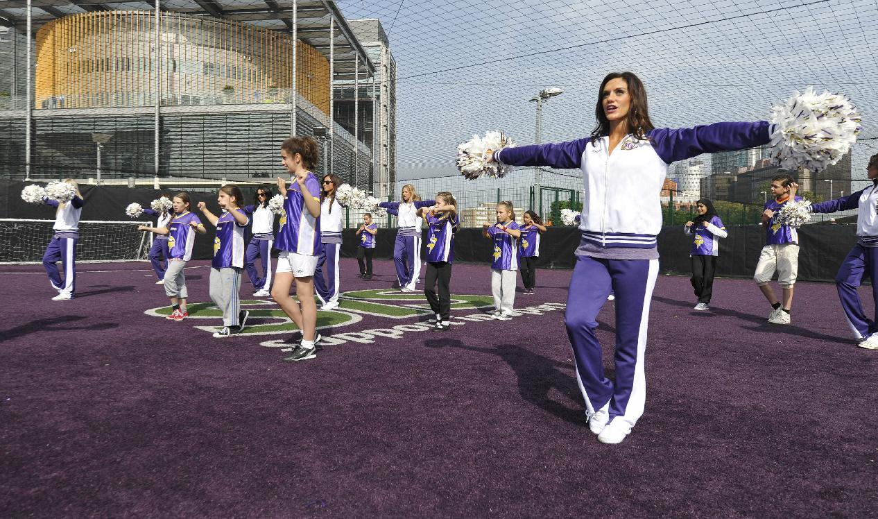 Minnesota Vikings cheerleaders take part in a football and cheerleading coaching clinic with London children near Wembley Stadium, London, Tuesday Sept. 24, 2013. The Pittsburgh Steelers are to play the Minnesota Vikings in the NFL International Series at Wembley Stadium in London on Sunday, Sept 29