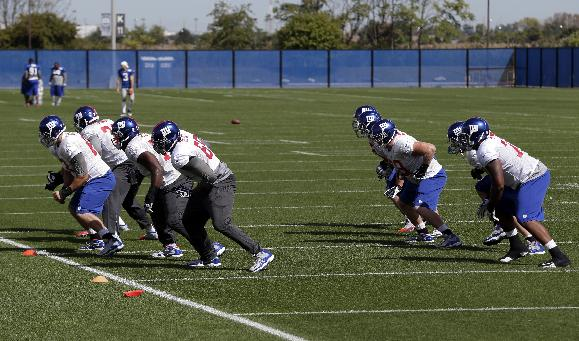 Members of the New York Giants offensive line work out during NFL football practice, Wednesday, Sept. 25, 2013, in East Rutherford, N.J