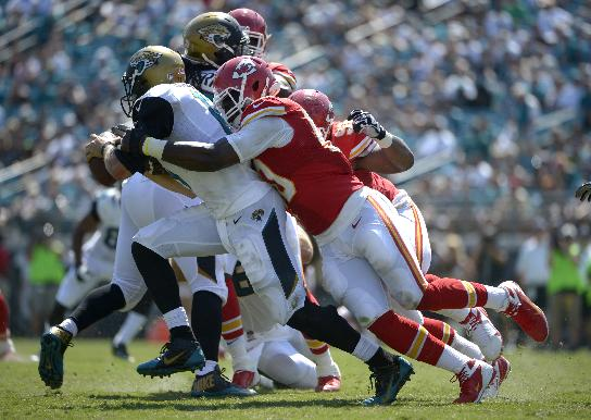In this Sept. 8, 2013 file photo, Jacksonville Jaguars quarterback Blaine Gabbert (11) is sacked by Kansas City Chiefs outside linebacker Justin Houston (50) during the second half of an NFL football game in Jacksonville, Fla. Houston's had four games of three-plus sacks already in his career, and his total of 23 sacks in 35 games makes him the third-fastest to reach the 20-sack plateau in franchise history