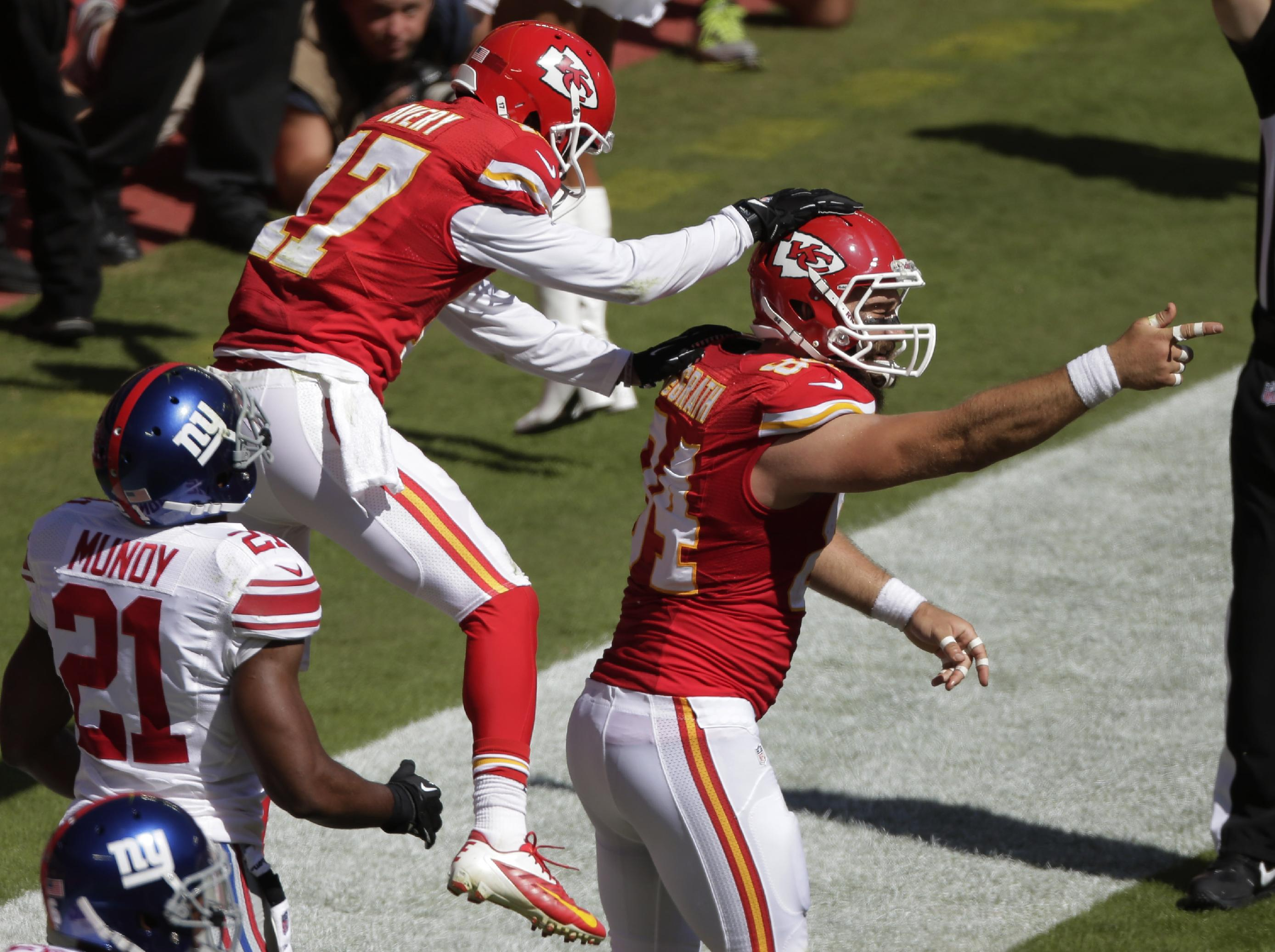 Kansas City Chiefs tight end Sean McGrath (84) celebrates a touchdown with wide receiver Donnie Avery (17) during the first half of an NFL football game against the New York Giants at Arrowhead Stadium in Kansas City, Mo., Sunday, Sept. 29, 2013. Giants free safety Ryan Mundy (21) watches the celebration