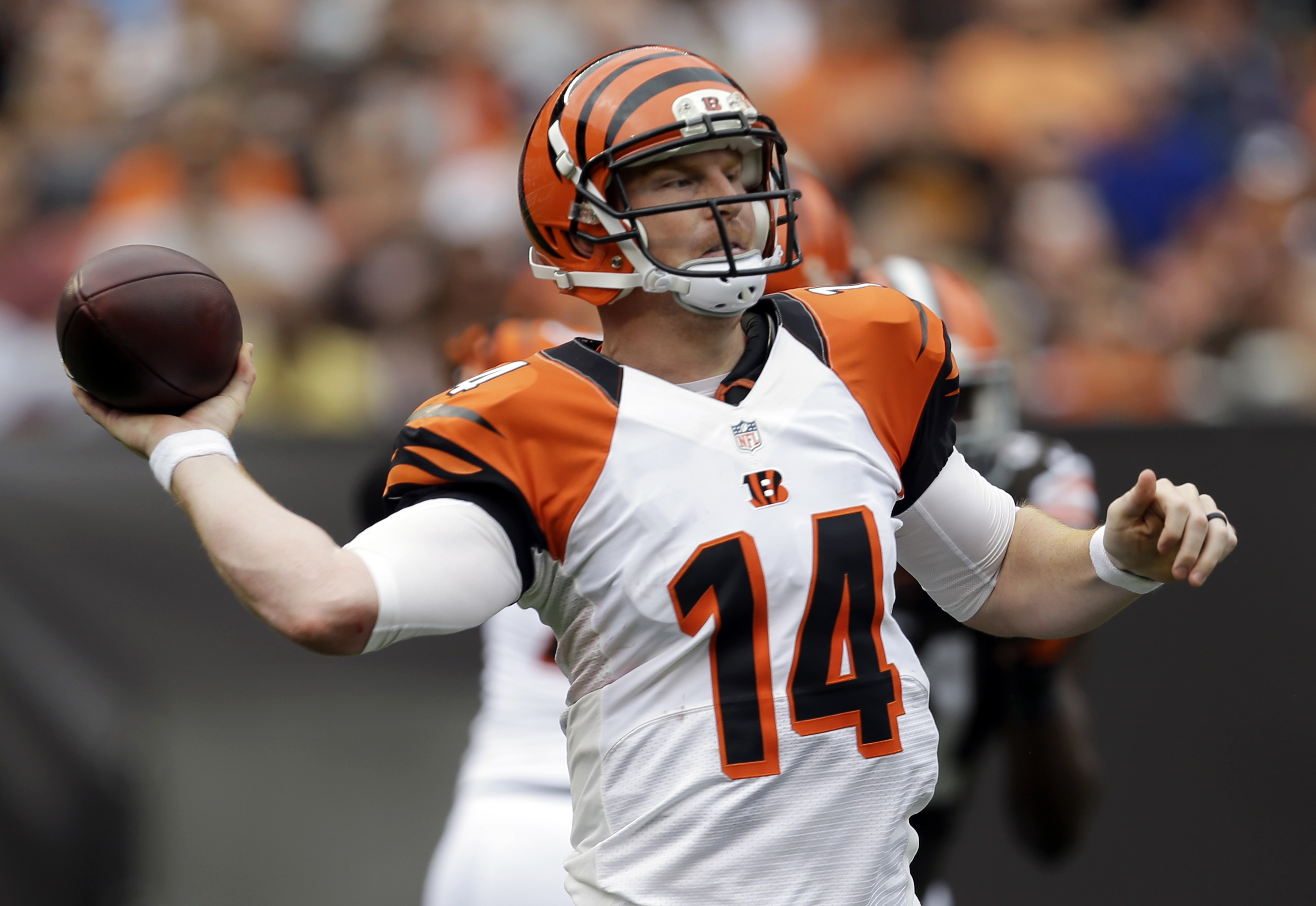 Cincinnati Bengals quarterback Andy Dalton passes in the third quarter of an NFL football game against the Cleveland Browns, Sunday, Sept. 29, 2013, in Cleveland