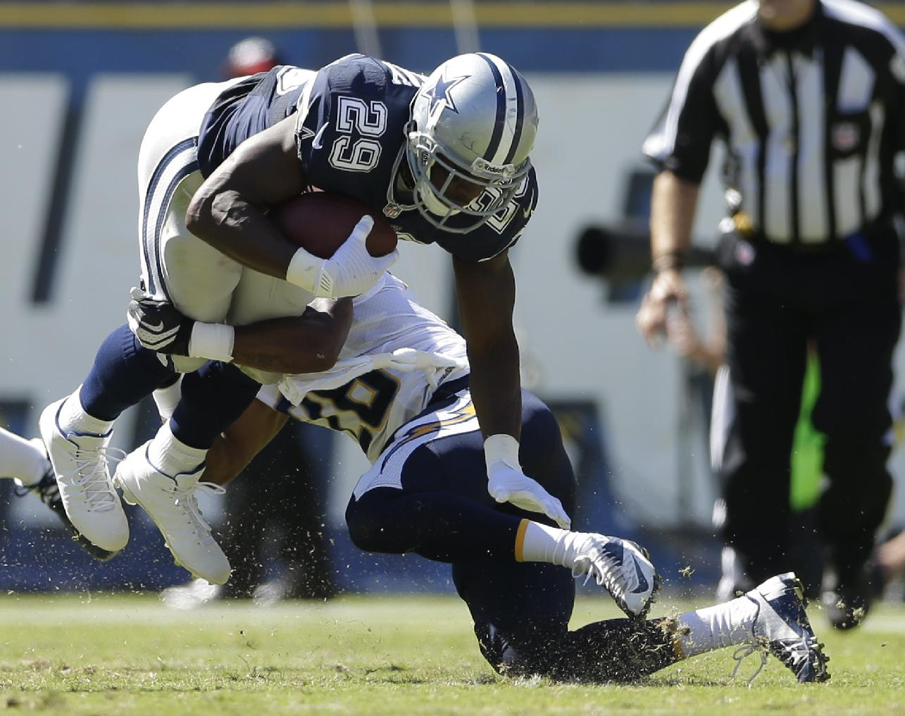 San Diego Chargers cornerback Johnny Patrick, right, tackles Dallas Cowboys running back DeMarco Murray during the first half of an NFL football game Sunday, Sept. 29, 2013, in San Diego. Patrick was hunt on the play
