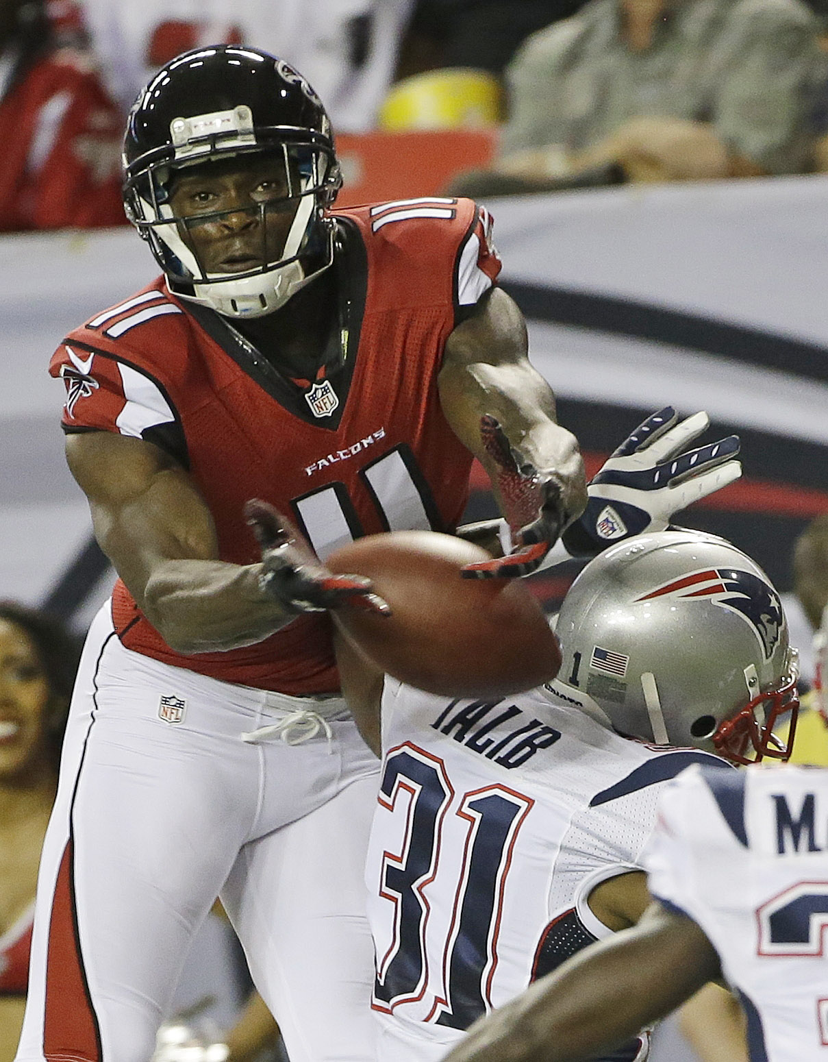 Atlanta Falcons wide receiver Julio Jones (11) attempts a catch against New England Patriots cornerback Aqib Talib (31) during the first half of an NFL football game, Sunday, Sept. 29, 2013, in Atlanta