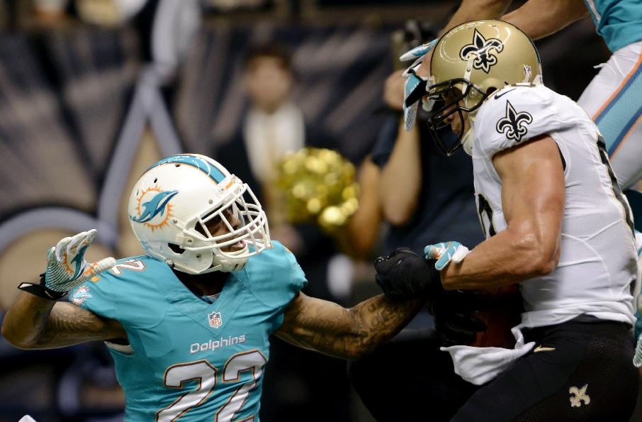 New Orleans Saints tight end Jimmy Graham (80) pulls in a touchdown reception over Miami Dolphins cornerback Jamar Taylor (22) in the first half of an NFL football game in New Orleans, Monday, Sept. 30, 2013