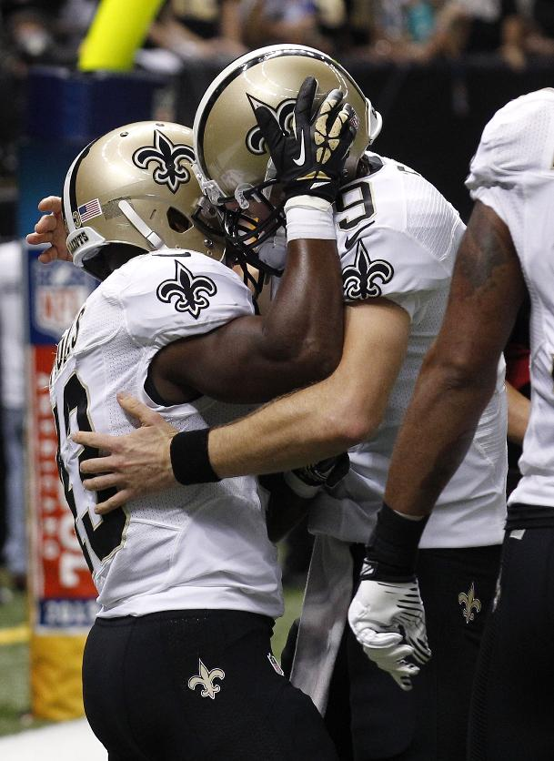 New Orleans Saints running back Darren Sproles (43) celebrates his touchdown reception with quarterback Drew Brees (9) in the first half of an NFL football game in New Orleans, Monday, Sept. 30, 2013