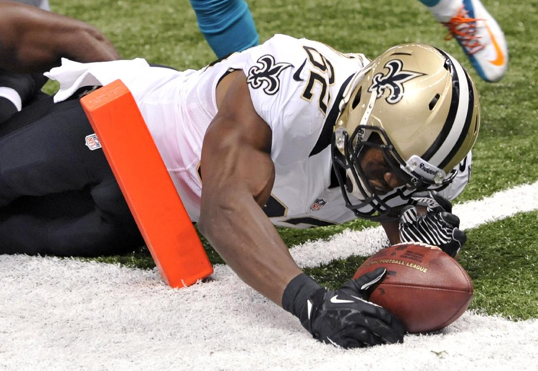 New Orleans Saints tight end Benjamin Watson (82) reaches over the pylon to score a touchdown in the second half of an NFL football game against the Miami Dolphins in New Orleans, Monday, Sept. 30, 2013