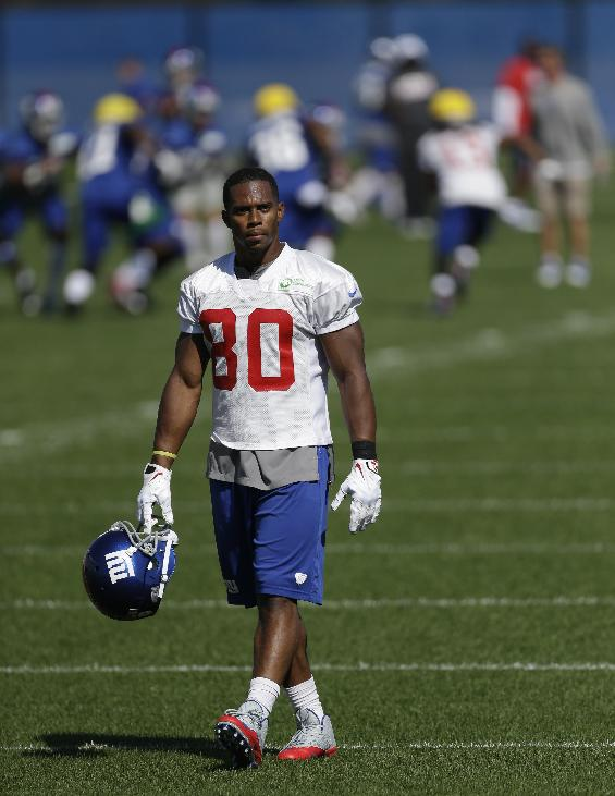 New York Giants wide receiver Victor Cruz walks on the field during NFL football practice, Wednesday, Oct. 2, 2013, in East Rutherford, N.J