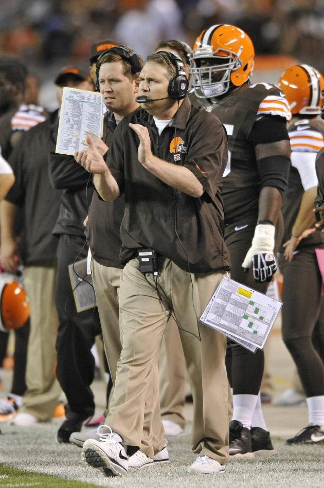 Cleveland Browns coach Rob Chudzinski cheers from the sidelines in the second quarter of an NFL football game against the Buffalo Bills on Thursday, Oct. 3, 2013, in Cleveland