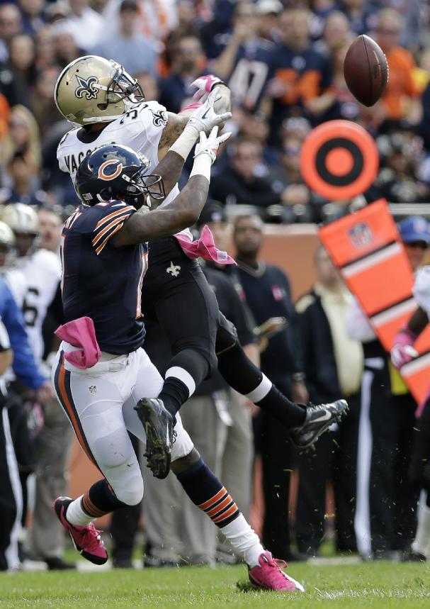 New Orleans Saints strong safety Kenny Vaccaro (32) breaks up a pass intended for Chicago Bears wide receiver Alshon Jeffery (17) during the first half of an NFL football game, Sunday, Oct. 6, 2013, in Chicago