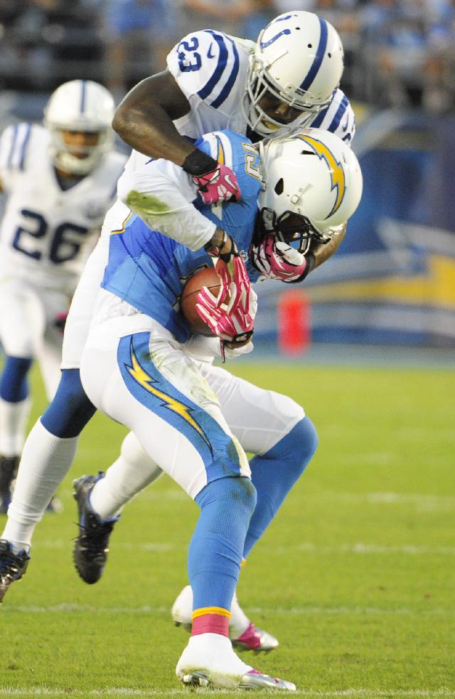 Indianapolis Colts cornerback Vontae Davis, above, hauls down San Diego Chargers wide receiver Keenan Allen, below, during the first half of an NFL football game Monday, Oct. 14, 2013, in San Diego