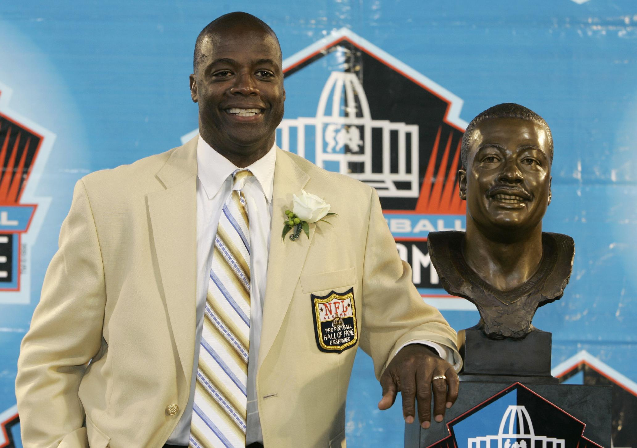 In this Aug. 2, 2008 file photo, former Washington Redskins cornerback Darrell Green stands next to his bronze bust at the Pro Football Hall of Fame in Canton, Ohio. The former Redskins cornerback looks around today's NFL and sees a lack of talent at his old job