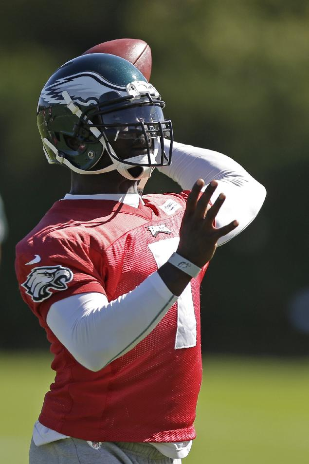 Philadelphia Eagles quarterback Michael Vick throws a pass during practice at the NFL football team's training facility, Tuesday, Oct. 15, 2013, in Philadelphia