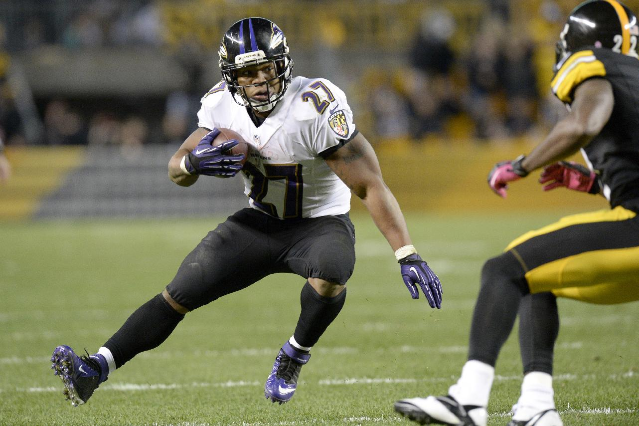 Baltimore Ravens running back Ray Rice (27) tries to get around Pittsburgh Steelers cornerback William Gay in the fourth quarter of an NFL football game on Sunday, Oct. 20, 2013, in Pittsburgh