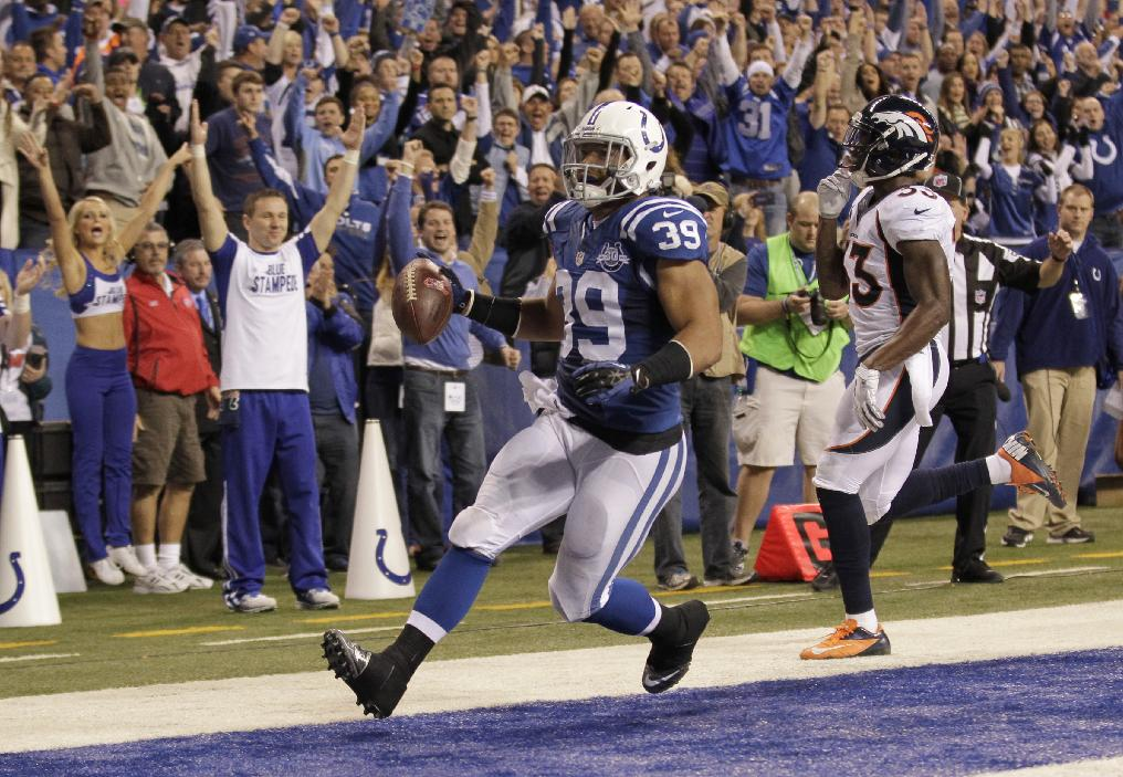 Indianapolis Colts fullback Stanley Havili (39) celebrates his touchdown during the first half of an NFL football game against the Denver Broncos, Sunday, Oct. 20, 2013, in Indianapolis