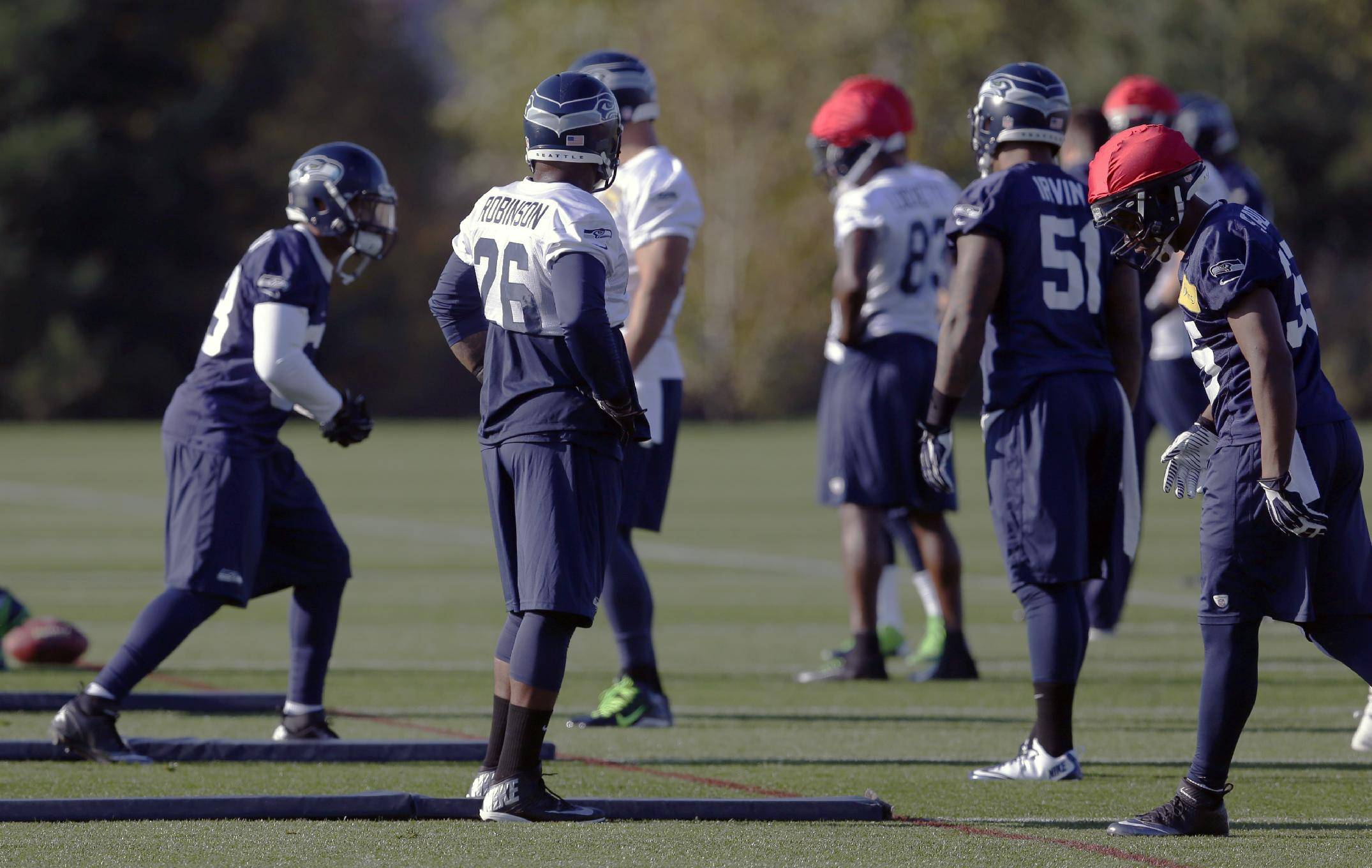 Seattle Seahawks fullback Michael Robinson (26) takes part in an NFL football practice, Tuesday, Oct. 22, 2013, in Renton, Wash