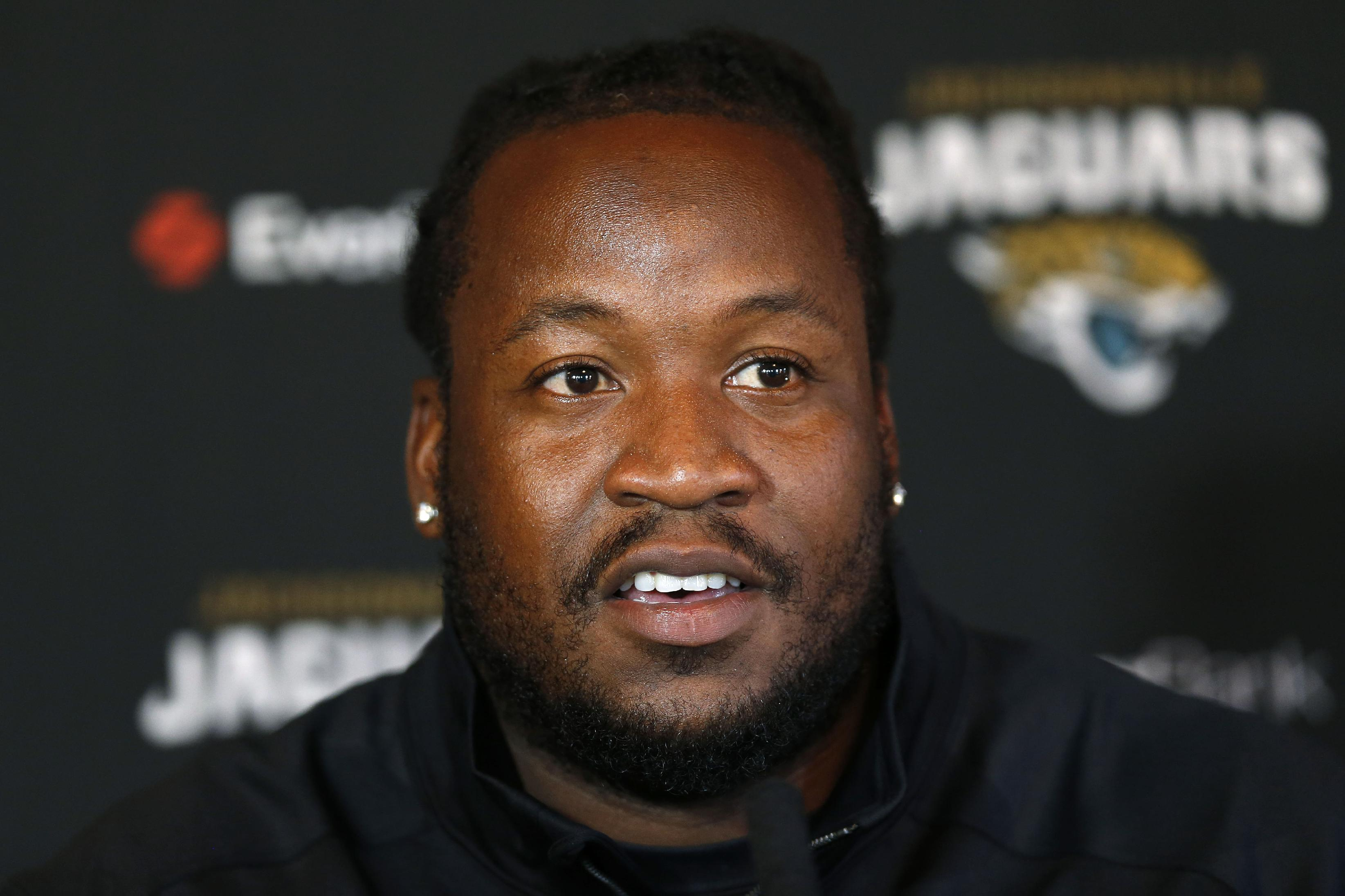 Jacksonville Jaguars' guard Uche Nwaneri speaks to the media during a press conference at the Pennyhill Park Hotel and Spa in Bagshot, England, Wednesday, Oct. 23, 2013. Jaguars play San Francisco 49ers on Sunday in a NFL football game at Wembley Stadium  in London