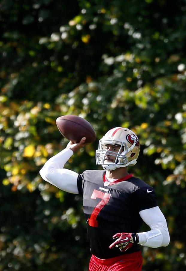San Francisco 49ers quarterback Colin Kaepernick makes a pass during an NFL training session at the Grove Hotel in Chandler's Cross, England, Thursday, Oct. 24, 2013.  The San Francisco 49ers are due to play the the Jacksonville Jaguars at Wembley stadium in London on Sunday, Oct. 27 in a regular season NFL game