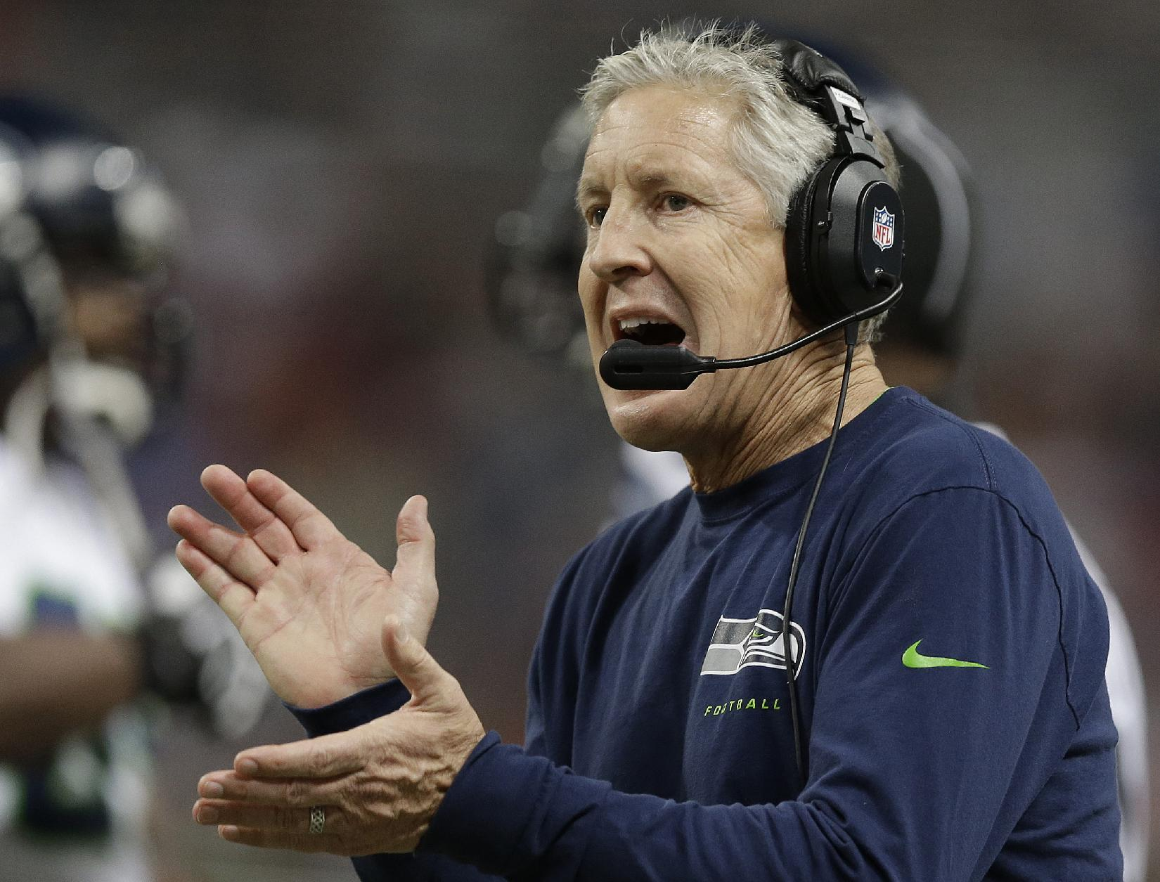 Seattle Seahawks head coach Pete Carroll works during the first half of an NFL football game against the St. Louis Rams, Monday, Oct. 28, 2013, in St. Louis