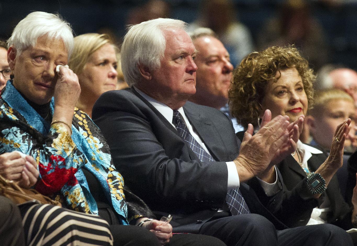Bum Phillips' wife, Debbie, left; son Wade; and Wade Phillips' wife, Laurie, attend a memorial service for Bum Phillips on Tuesday, Oct. 29, 2013, in Houston. Phillips, the former Houston Oilers and New Orleans Saints coach, died Oct. 18 at age 90