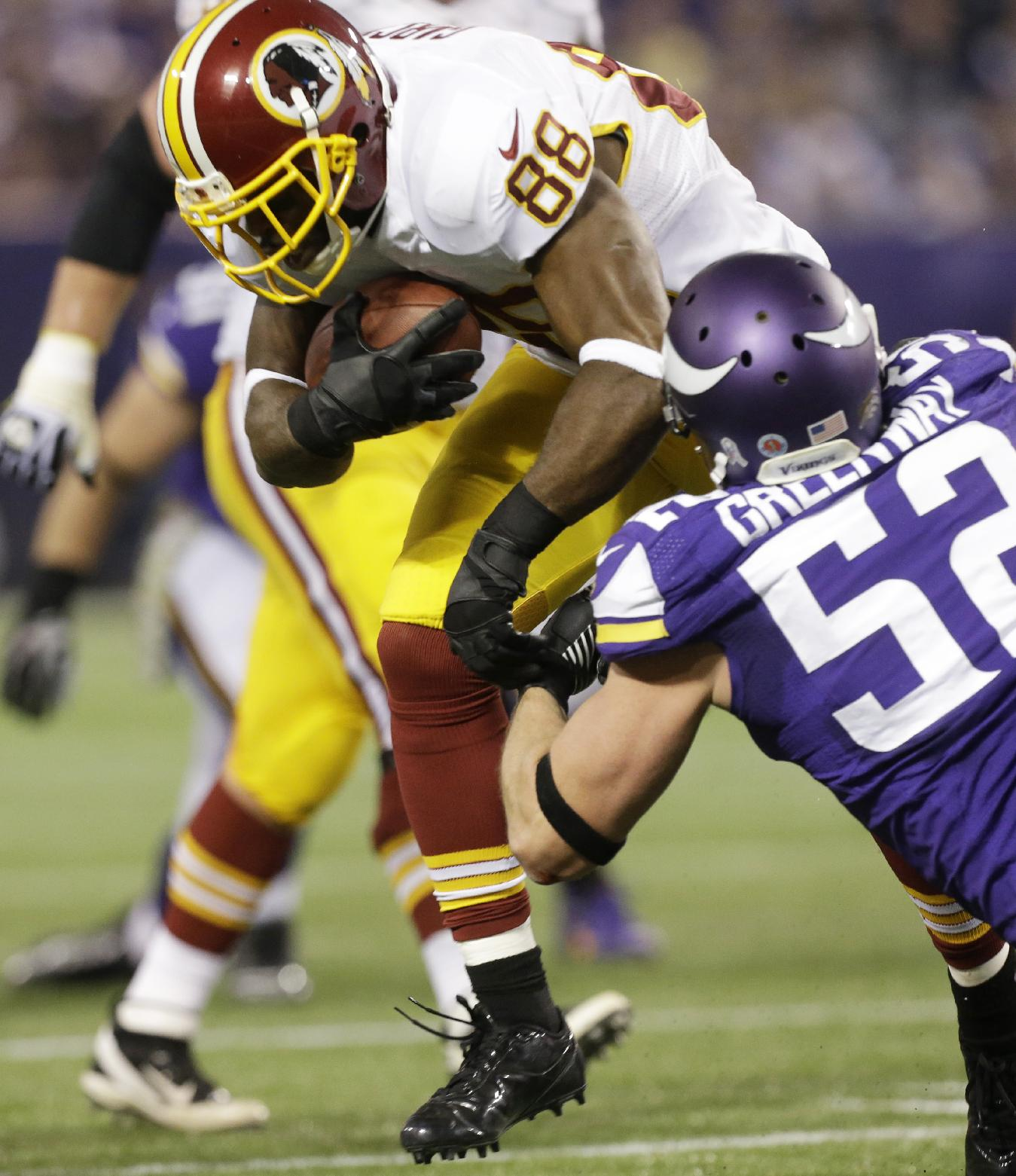 Washington Redskins wide receiver Pierre Garcon (88) tries to break a tackle by Minnesota Vikings outside linebacker Chad Greenway, right, after making a reception during the first half of an NFL football game Thursday, Nov. 7, 2013, in Minneapolis