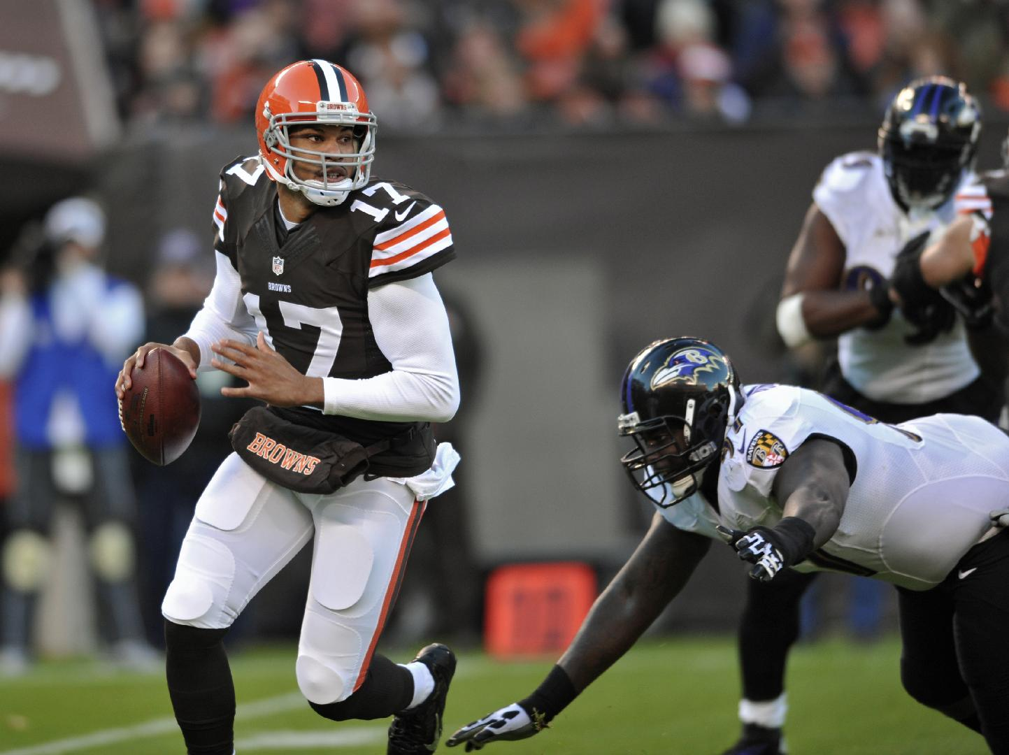 FILE-In this Sunday, Nov. 3, 2013 file photo shows Cleveland Browns quarterback Jason Campbell (17) scrambling before being sacked by the Baltimore Ravens in the first quarter of an NFL football game. Campbell was hoping to resurrect his career when he signed with the Browns