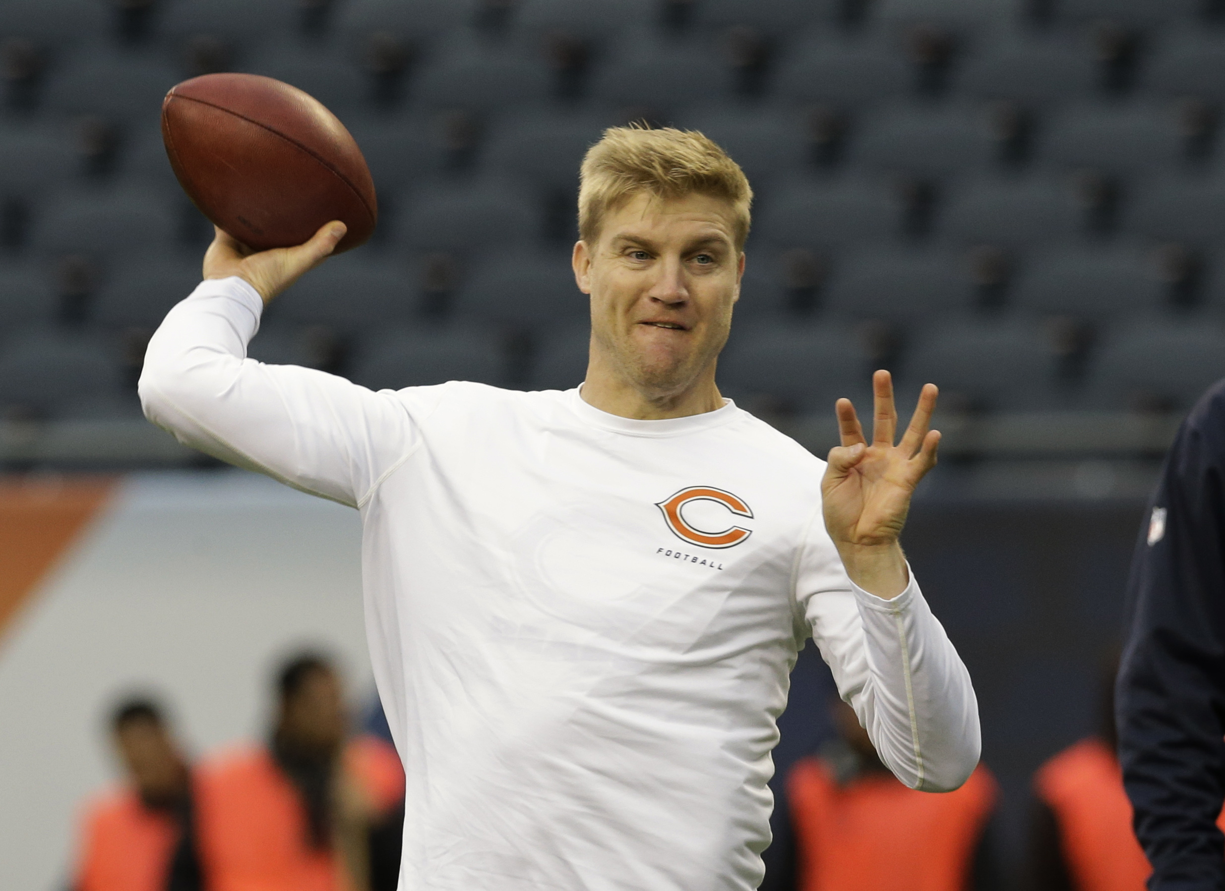 Chicago Bears quarterback Josh McCown (12) warms up before an NFL football game against the Baltimore Ravens, Sunday, Nov. 17, 2013, in Chicago